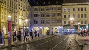 Night view of the illuminated malostranske namesti square timelapse hyperlapse in prague. Which lies just under the prague castle and which is famous for church stock footage