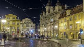 Night view of the illuminated malostranske namesti square timelapse hyperlapse in prague. Which lies just under the prague castle and which is famous for church stock video