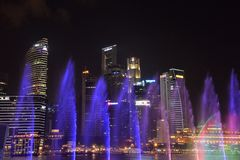 Singapore skyline by night, Marina bay and skyscraper view. Night view of the illuminated Marina Bay front buildings, Singapore. Waterfront by night Stock Photo