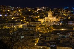 Night view of the illuminated Modica and the San Giorgio cathedral. Night view of the illuminated Modica and the imposing San Giorgio cathedral Stock Photos