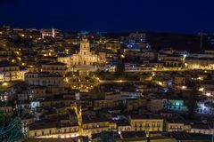 Night view of the illuminated Modica and San Giorgio church. Night view of the illuminated Modica and the imposing San Giorgio cathedral Royalty Free Stock Image