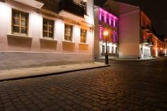 Night view of illuminated old street. Belarus. Minsk stock image