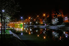 Night view of the illuminated river Bega in Timisoara. TIMISOARA, ROMANIA - APRIL 1, 2016: Night view of the illuminated river Bega in Timisoara, Romania royalty free stock images