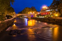 Night view of Sochi river and Rivyerskiy bridge. Night view of illuminated Rivyerskiy bridge and Sochi river with embankment, Sochi, Russia Royalty Free Stock Image