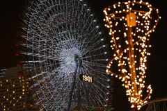 Illuminations of the Ferris wheel. Night view of the illuminations of the Ferris wheel of the amusement park royalty free stock photos