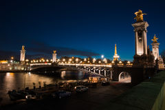 Night view on iluminated bridge in Paris France. Night view on iluminated Alexander III bridge and Eiffel Tower in Paris , France Stock Photography