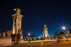 Night view on iluminated bridge in Paris France. Night view on iluminated Alexander III bridge and Eiffel Tower in Paris , France Royalty Free Stock Photos