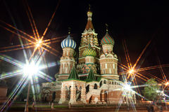 Night view of Intercession Cathedral St. Basil's  through rays o Stock Photos