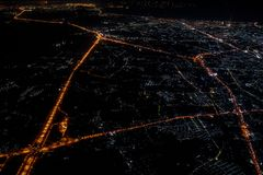Night view from the jetplane in twilight time with the red sky and light of the city. Night view from the  jetplane in twilight time with the red sky and light royalty free stock photo