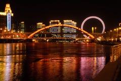 Night view of Jingang bridge and the eye of Tianji. This is a Chinese bridge, called Jingang Bridge, located in Tianjin, Haihe River.Tianjin Eye Ferris wheel is royalty free stock photo