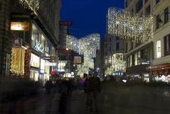 Night view of Kartner street in Vienna. VIENNA, AUSTRIA - JANUARY 1 2016: Night view of Kartner street in Vienna at winter time, with Christmas decoration and Royalty Free Stock Images