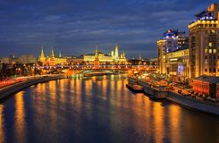 Night view of Kremlin and Moscow river embankment. Royalty Free Stock Photos