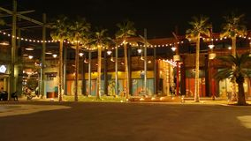 Night view of La Mer, a beautiful tourist attraction in Dubai with light decorations and stores stock video footage