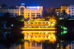 Night view of the lake side in Hoan Kiem Lake. Hoan Kiem Lake meaning `Lake of the Returned Sword`. Stock Photo
