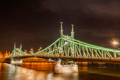 Night view of Liberty Bridge in Budapest, Hungary. Night view of Liberty Bridge or Freedom Bridge in Budapest, Hungary, connects Buda and Pest across the River Stock Images