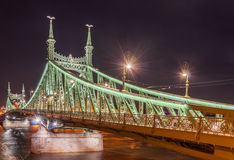 Night view of Liberty Bridge or Freedom Bridge in Budapest, Hungary. Connects Buda and Pest across the River Danube Royalty Free Stock Photo