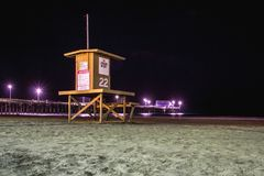 Night view of a lifeguard tower, Newport Beach, California stock images