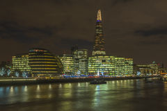 Night view of London's cityscape. LONDON, UK - DECEMBER 04, 2015: Night view of London's cityscape across river Thames including the Shard, City Hall and modern Stock Images