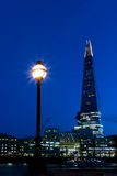 Night View of London Skyline. Night view of the London skyline showing The Shard and a street lamp royalty free stock photo