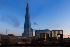 Night View of London Skyline. Sunset on the London skyline showing The Shard and office buildings royalty free stock photography