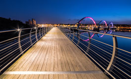 Night view for long pedestrian bridge in Solvesborg at summer time Stock Image