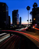 Night view of Los Angeles freeway and buildings. A night scene of a Los Angeles freeway with business buildings in the background take during the blue hour Royalty Free Stock Photo