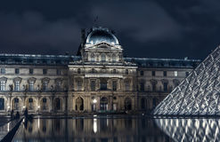 Night view of The Louvre museum with crystal pyramid Royalty Free Stock Photo