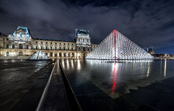 Night view of The Louvre museum with crystal pyramid Stock Photos