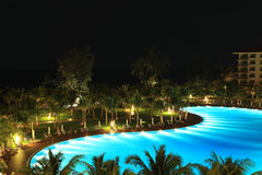 Night view of a luxury resort. With large swimming pool Royalty Free Stock Images