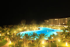 Night view of a luxury resort. With large swimming pool Royalty Free Stock Image