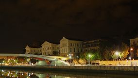 Night view of main building of University of Deusto, Bilbao, Spain, time lapse. Stock footage stock video footage