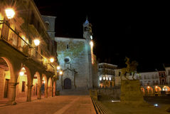 Night view of the main square of Trujillo (Spain). Night view of the main square (plaza mayor) of Trujillo (Spain) with an arcade in the fonrt and the equestrian Stock Photography