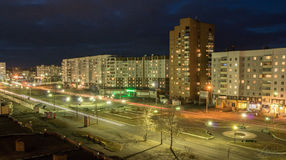 Night view on the main street in Siberian town. View from the top apartment of the main street. the long exposure with street lights,  apartments window lights Royalty Free Stock Image
