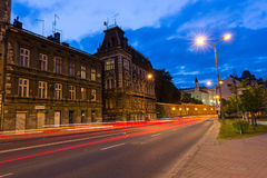 Night view on main Zamkowa street with old tenement houses Royalty Free Stock Photography