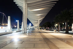 Night view of Malaga promenade in the evening. Royalty Free Stock Images