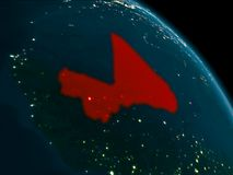 Night view of Mali on Earth. Orbit view of Mali at night highlighted in red on planet Earth with highly detailed surface textures. 3D illustration. Elements of Royalty Free Stock Photo