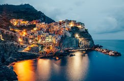 Night view of Manarola fishing village in Cinque Terre, Italy Royalty Free Stock Photo