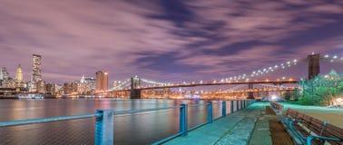 The night view of manhattan and brooklyn bridge Stock Photos