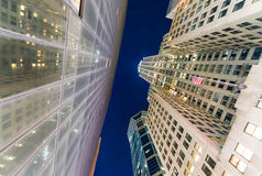 Night view of Manhattan skyscrapers from the street Stock Photography