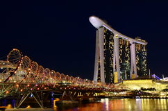 Night skyline at marina bay sands in singapore. Singapores Double Helix Bridge with Marina Bay Sands and Sky Park in the night Stock Photos