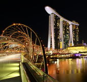 Night scene of marina bay sands in singapore. Singapores Double Helix Bridge with Marina Bay Sands and Sky Park in the night Stock Photos