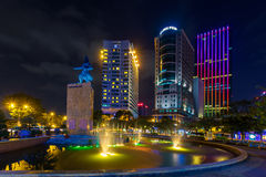 night view of the Me Linh square and buildings around at downtown of in Hochiminh city, Vietnam, near Saigon riverside. Royalty Free Stock Photo