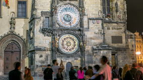 Night view of the medieval astronomical clock in the Old Town square timelapse in Prague. People watch the show stock footage