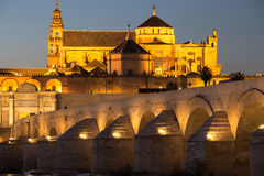 Night view of Mezquita-Catedral and Puente Romano - Mosque-Cathe Stock Photography