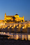 Night view of Mezquita-Catedral and Puente Romano - Mosque-Cathe Stock Photo
