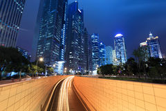 Night view of modern building and tunnel Stock Photos