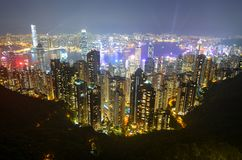 Night view of modern buildings along Victoria Harbour in Hong Kong. Dazzling night time view of the urban landscape around Victoria Harbor in Hong Kong, China royalty free stock photos