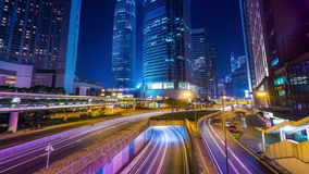 Night view of modern city traffic across street. Time lapse. Hong Kong