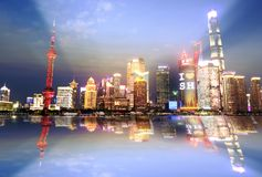 Night view of the modern Pudong skyline across the Bund in Shanghai, China. Shanghai is the largest Chinese city stock images