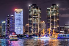 Night view of modern waterfront buildings, Shanghai, China. Beautiful night view of modern waterfront buildings at the Pudong New Area (Lujiazui) in downtown of stock images